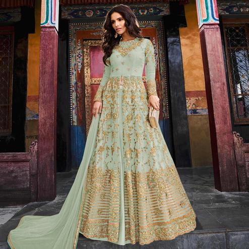 Appealing Pastel Green Colored Partywear Embroidered Netted Lehenga Kameez