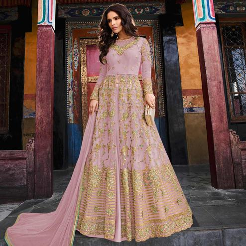 Adorning Pink Colored Partywear Embroidered Netted Lehenga Kameez