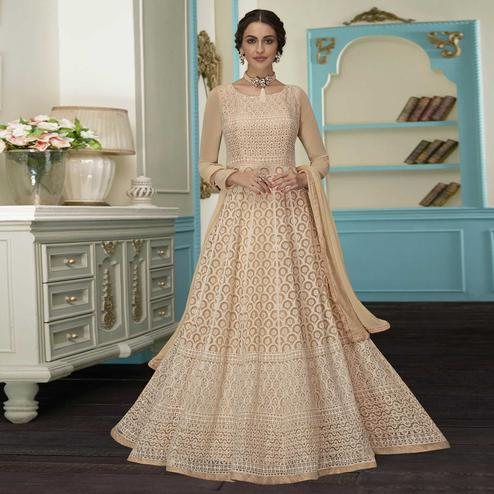Magnetic Beige Colored Partywear Embroidered Faux Georgette Suit