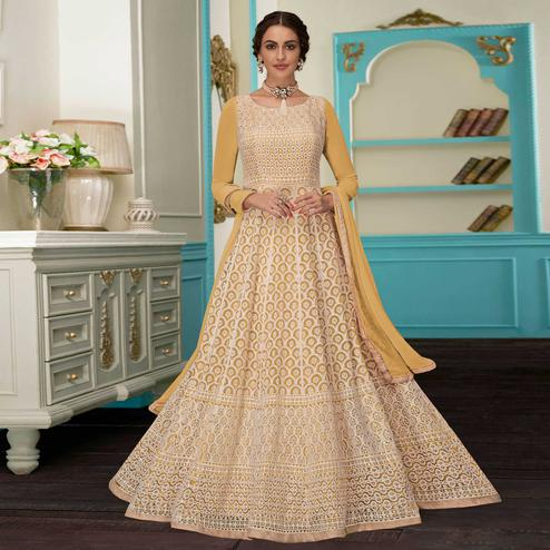 Excellent Yellow Colored Partywear Embroidered Faux Georgette Suit