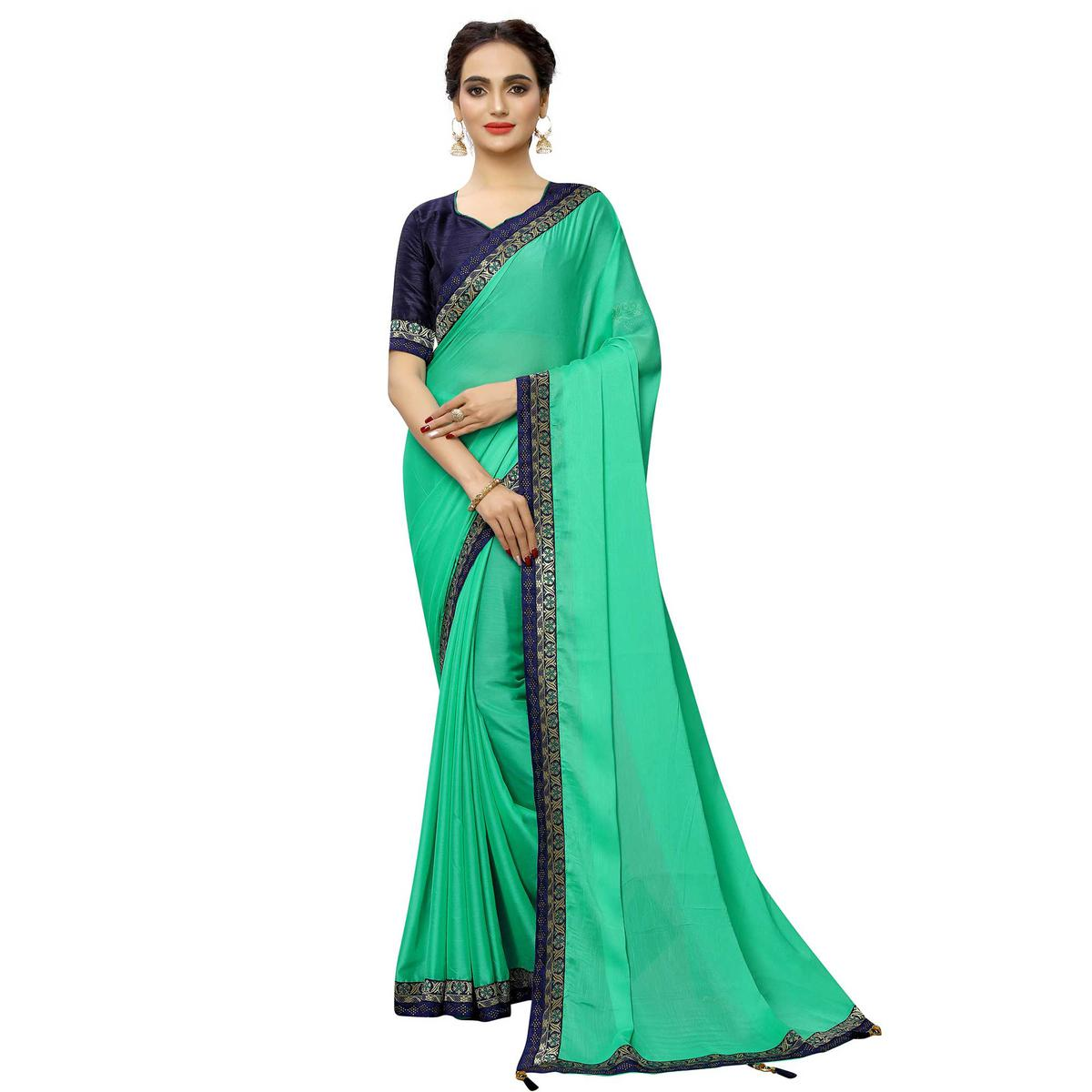 Gleaming Turquoise Green Colored Party Wear Printed Georgette Saree