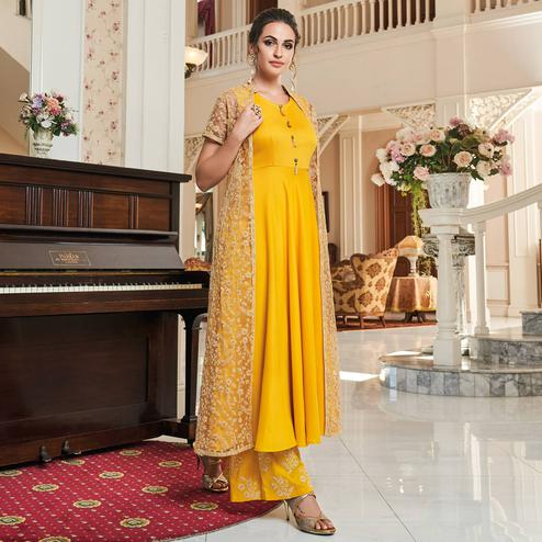 Pleasant Yellow Colored Partywear Embroidered Cotton Palazzo Suit With Long Jacket