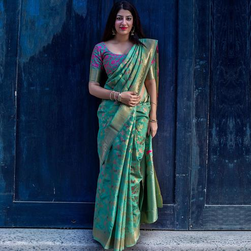 Majesty Turquoise Green Colored Festive Wear Woven Silk Saree