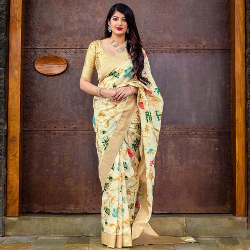 Flamboyant Cream Colored Festive Wear Banarasi Silk Saree
