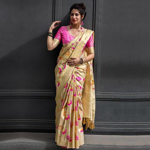 Unique Cream Colored Festive Wear Woven Silk Saree
