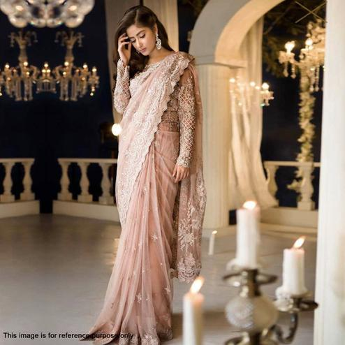 Ravishing Light Peach Colored Partywear Embroidered Netted Saree