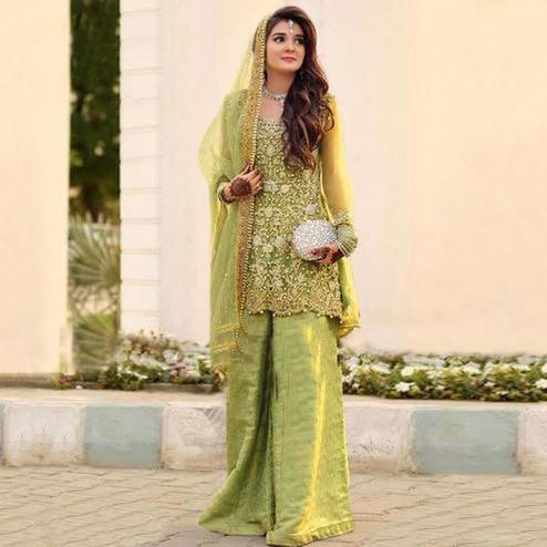 Dazzling Pista Green Colored Partywear Embroidered Netted Palazzo Suit