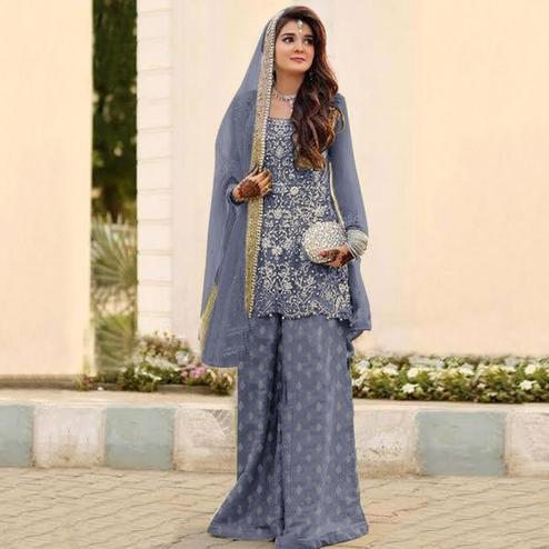 Surpassing Grey Colored Partywear Embroidered Netted Palazzo Suit