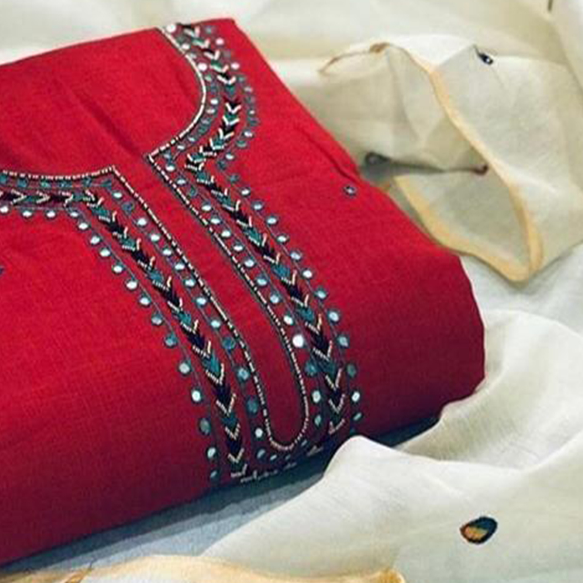 Magnetic Red Colored Partywear Embroidered Cotton Dress Material