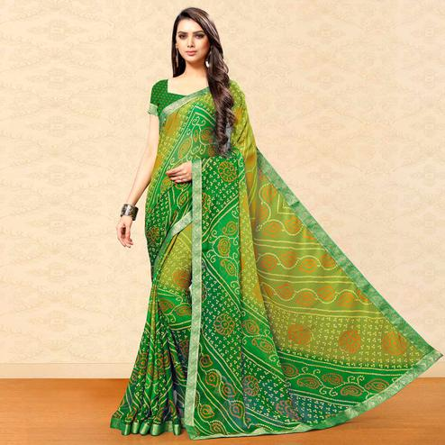 Unique Green Colored Party Wear Bandhani Printed Chiffon Saree