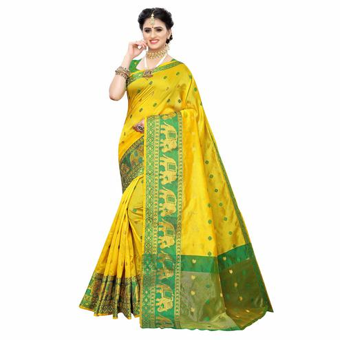 Pleasant Yellow Colored Festive Wear Woven Raw Silk Saree