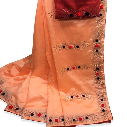 Engrossing Peach Colored Partywear Stone Work Zoya Silk Saree
