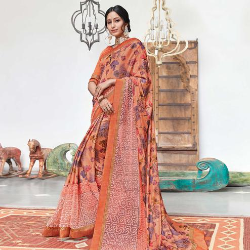 Jazzy Orange Colored Partywear Floral Digital Print With Embroidered Border Silk Saree