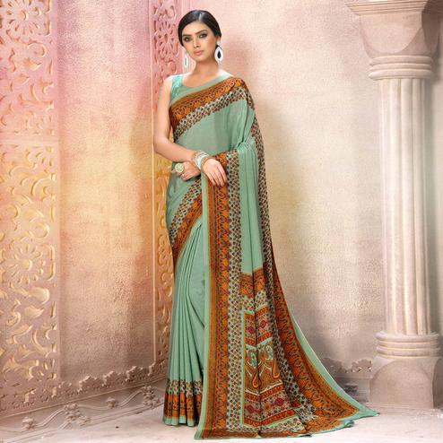 Desirable Light Auqa Blue Colored Casual Wear Printed Crepe Saree