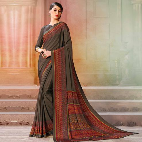 Sophisticated Blackish Grey Colored Casual Wear Printed Crepe Saree