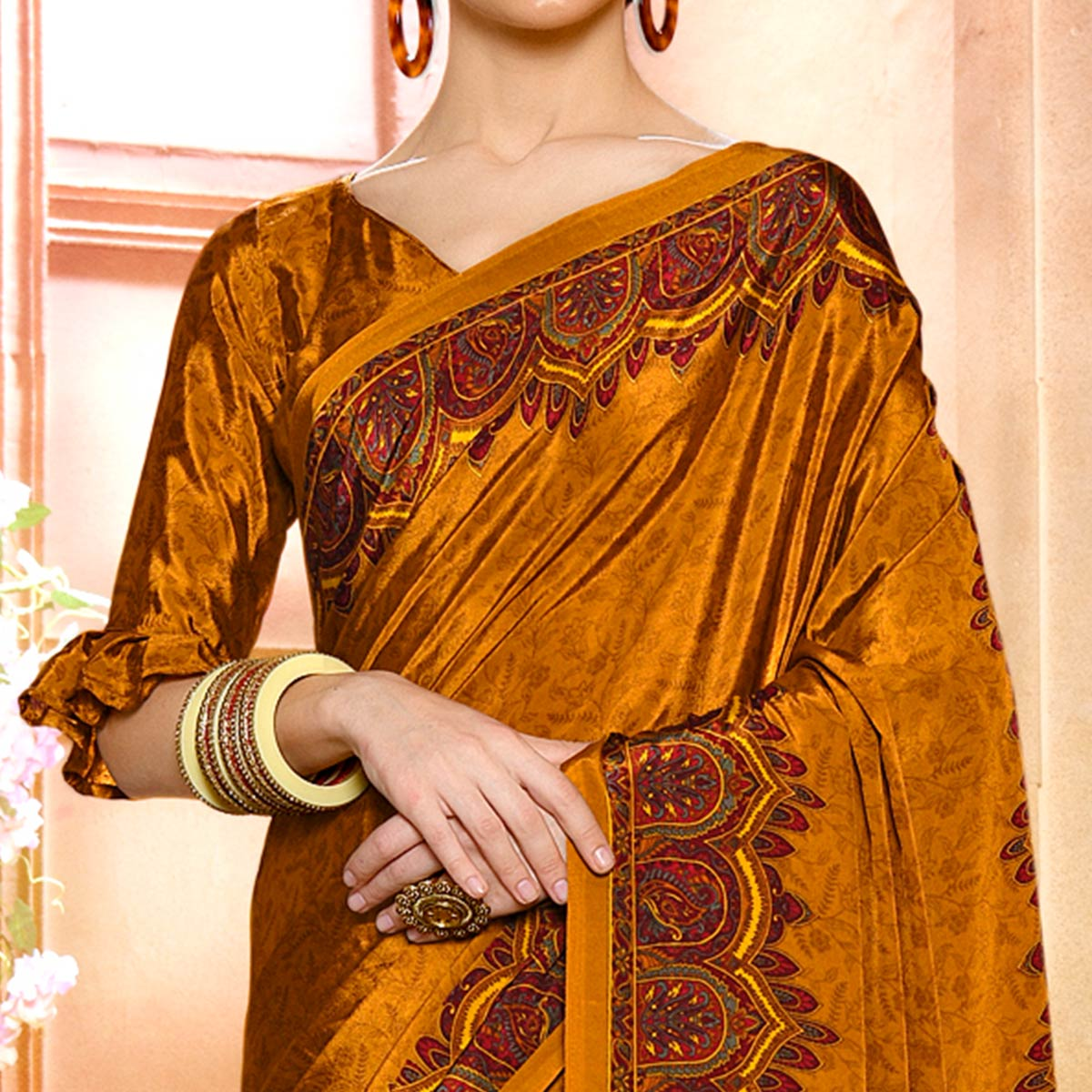Flattering Golden Colored Casual Wear Printed Crepe Saree