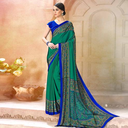 Surpassing Turquoise Green Colored Casual Wear Printed Crepe Saree