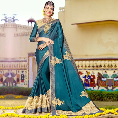 Elegant Teal Blue Colored Party Wear Floral Embroidered Art Silk Saree