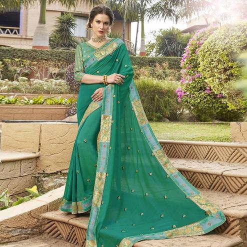 Flamboyant Turquoise Green Colored Party Wear Floral Embroidered Georgette Saree