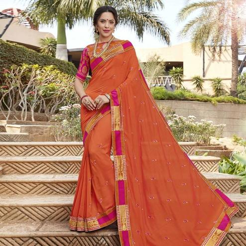 Pretty Orange Colored Party Wear Floral Embroidered Georgette Saree