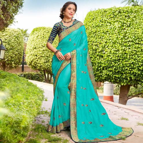 Alluring Aqua Blue Colored Party Wear Floral Embroidered Georgette Saree