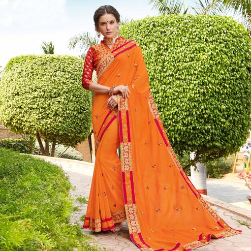 Flaunt Orange Colored Party Wear Floral Embroidered Georgette Saree