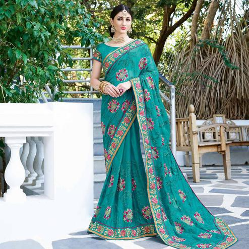 Opulent Sky Blue Colored Partywear Embroidered Georgette Silk Saree
