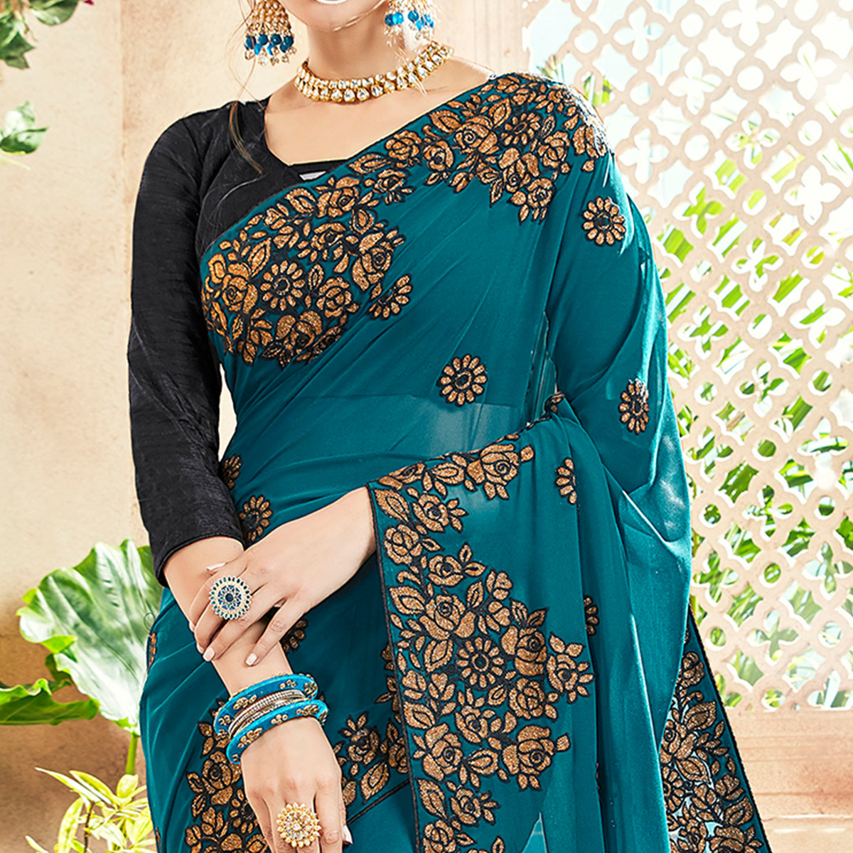 Gorgeous Teal Blue Colored Party Wear Floral Embroidered Georgette Saree