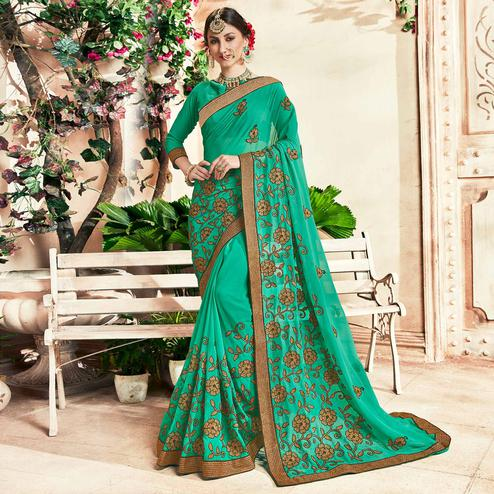 Majesty Turquoise Colored Party Wear Floral Embroidered Georgette Saree