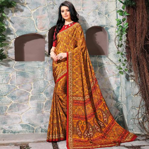 Glorious Orange Colored Casual Wear Printed Crepe Saree