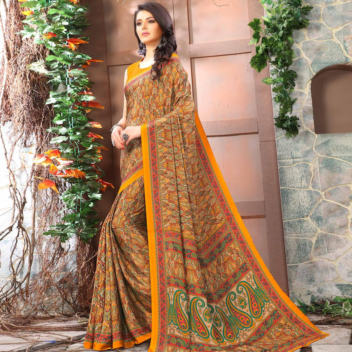 Captivating Yellow Colored Casual Wear Printed Crepe Saree