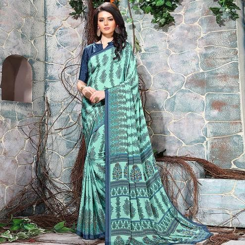 Innovative Aqua Green Colored Casual Wear Printed Crepe Saree