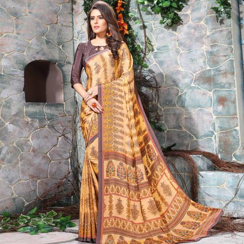Eye-catching Light Orange Colored Casual Wear Printed Crepe Saree