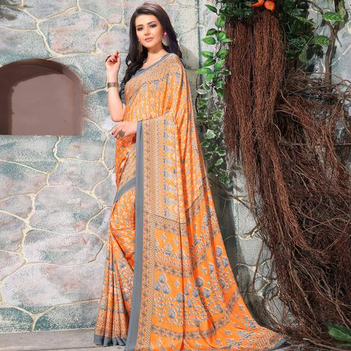 Lovely Orange Colored Casual Wear Printed Crepe Saree