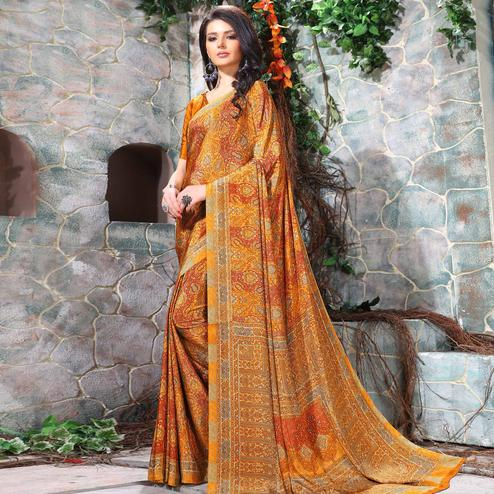 Hypnotic Orange Coloured Casual Wear Printed Crepe Saree