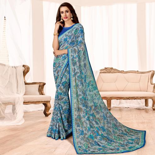Adorable Blue Colored Casual Wear Printed Georgette Saree