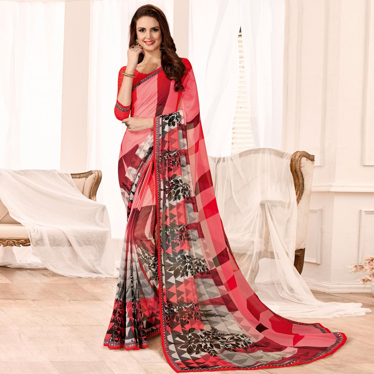 Beautiful Pink Colored Casual Wear Printed Georgette Saree