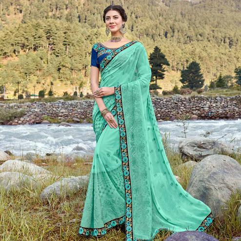 Appealing Turquoise Green Colored Party Wear Floral Embroidered Georgette Saree