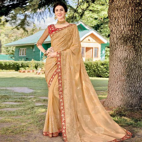 Adorning Beige Colored Party Wear Floral Embroidered Georgette Saree