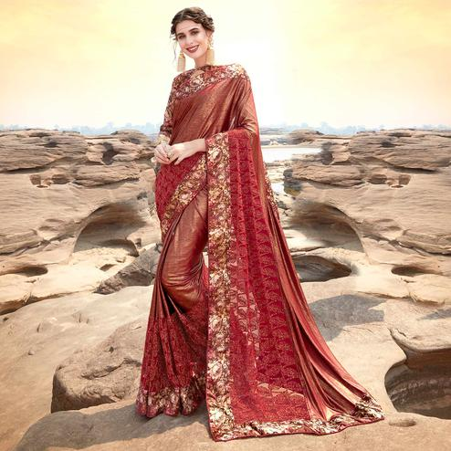 Arresting Maroon Colored Partywear Printed Lycra & Net Saree