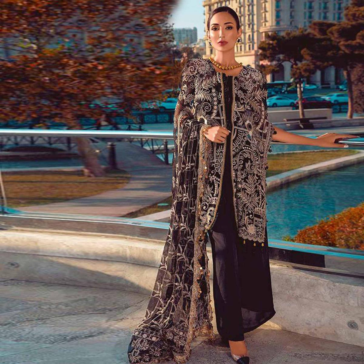 Alluring Black Colored Partywear Embroidered Net Jacket Style Palazzo Suit