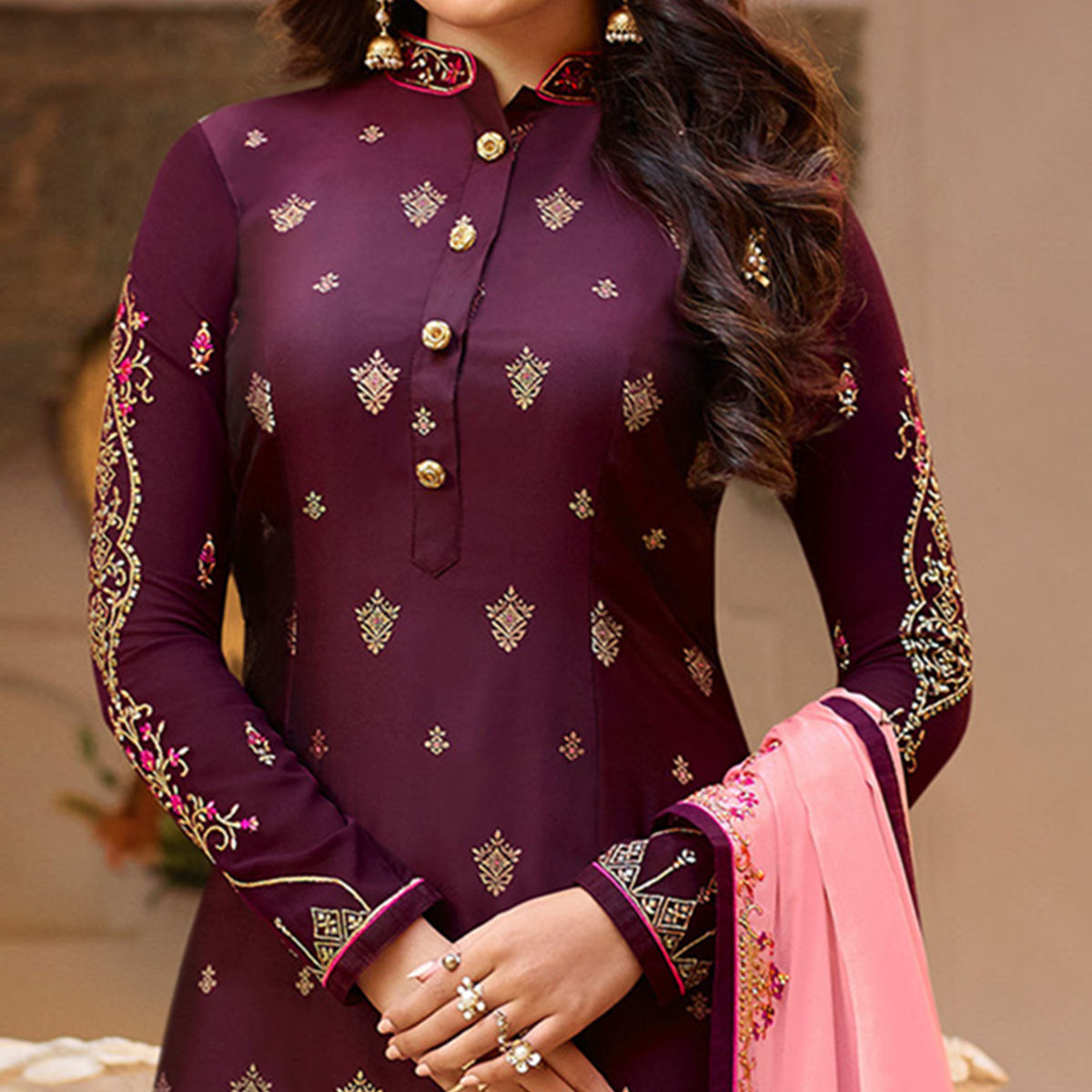 Delightful Purple Colored Partywear Embroidered Georgette Suit