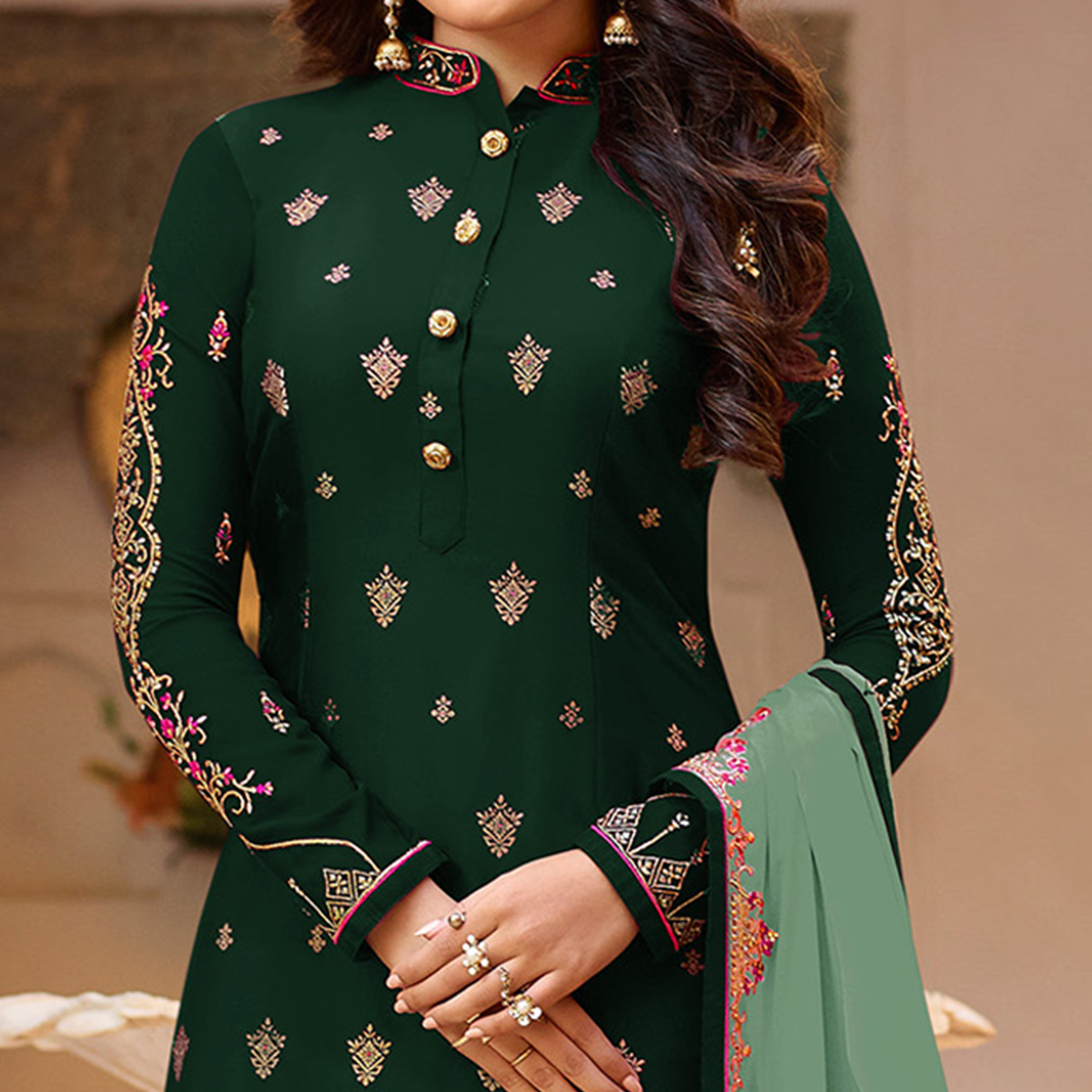 Innovative Green Colored Partywear Embroidered Georgette Suit