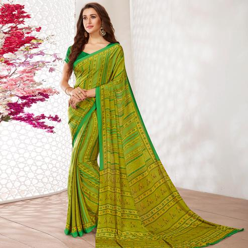 Charming Green Colored Casual Wear Printed Crepe Saree