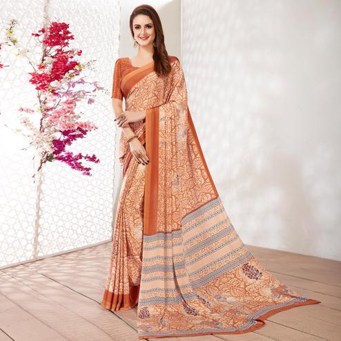 Eye-catching Orange Colored Casual Wear Printed Crepe Saree