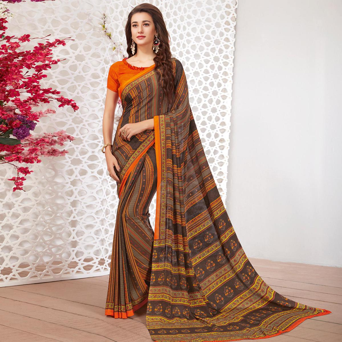 Gorgeous Grey Colored Casual Wear Printed Crepe Saree