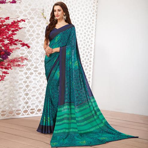 Dazzling Aqua Green-Navy Blue Colored Casual Wear Printed Crepe Saree