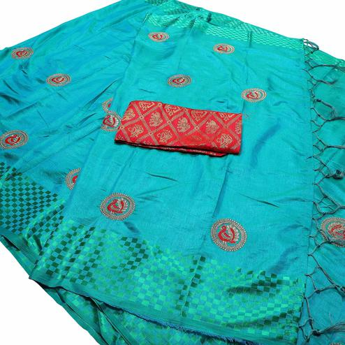 Desirable Sky Blue Colored Festive Wear Peacock Embroidered Banarasi Silk Saree With Tassel