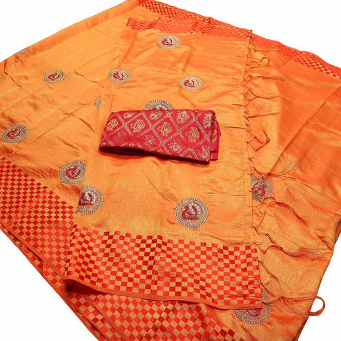 Exotic Light Orange Colored Festive Wear Peacock Embroidered Banarasi Silk Saree With Tassel