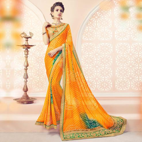 Delightful Yellow Colored Partywear Embroidered Bandhani Georgette Saree